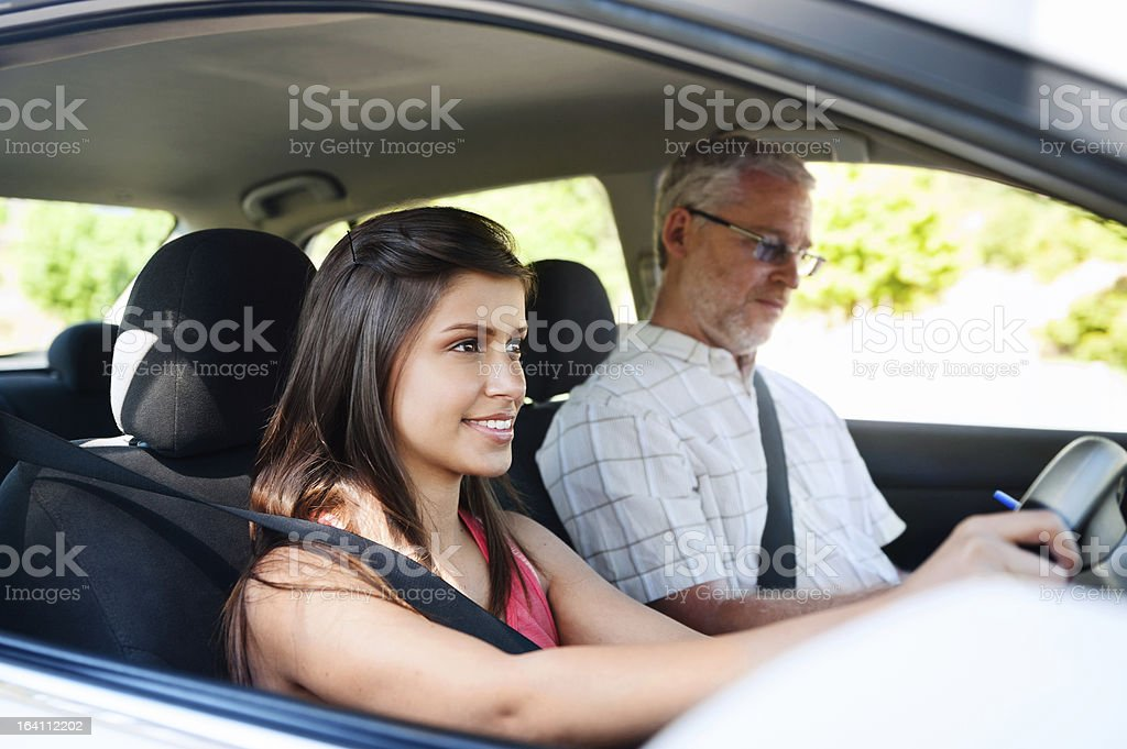 A female learning to drive with her instructor stock photo