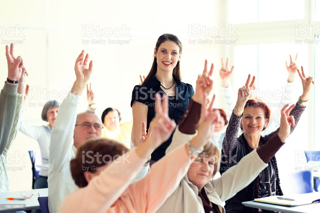 Female lecturer and adult students on seminar royalty-free stock photo