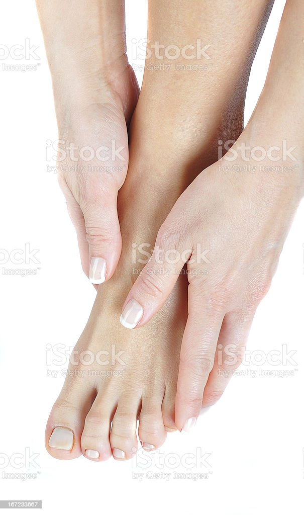 Female left foot with smooth skin on isolated white background stock photo