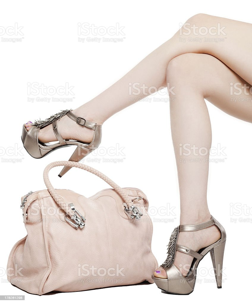 Female legs and handbag stock photo