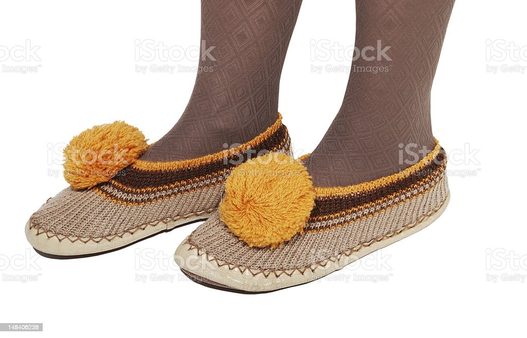 Female legs in the house slippers. stock photo