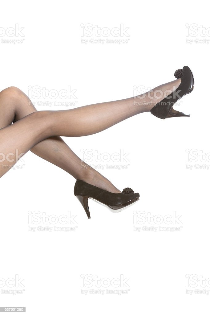 Female legs in tights and high heels stock photo