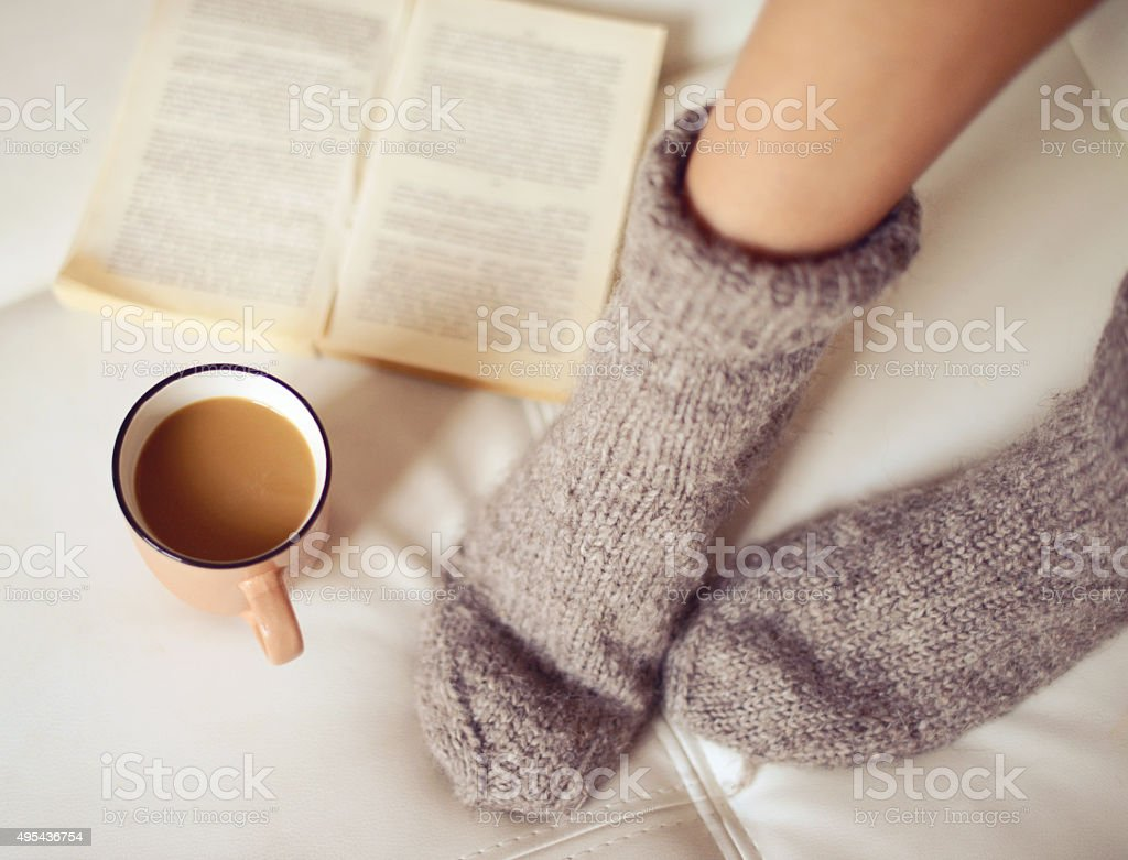 female legs in woolen socks close up stock photo