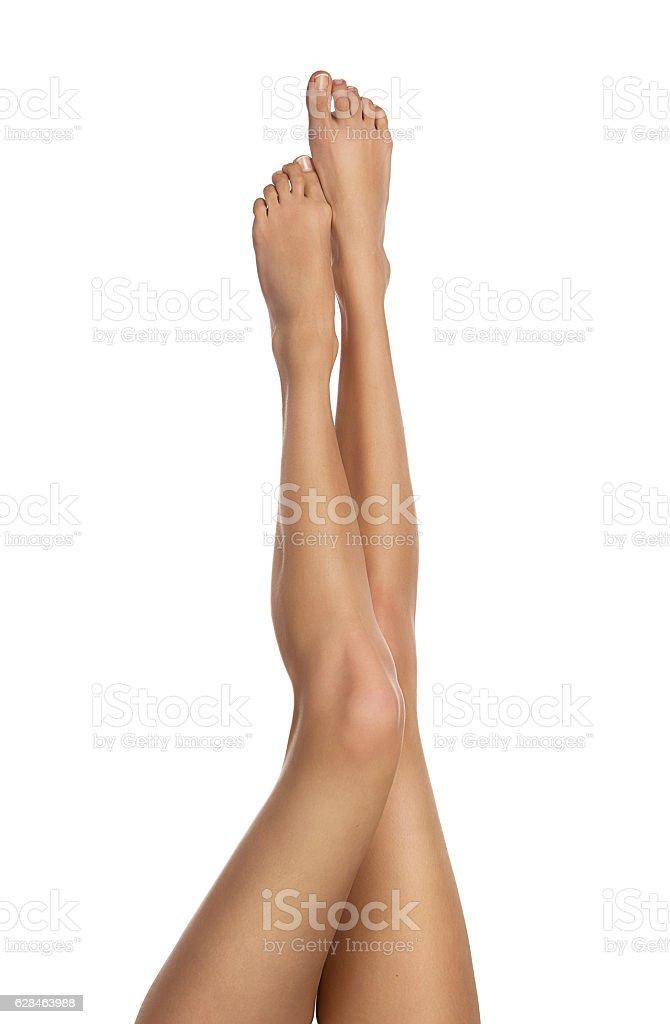 Female legs isolated on white stock photo