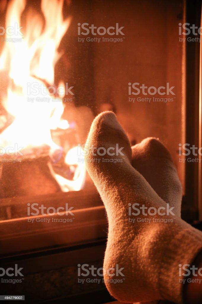 female legs near the fireplace stock photo