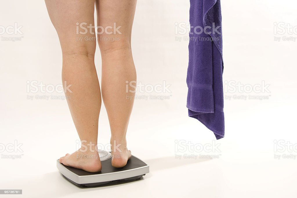 Female legs on a scale royalty-free stock photo