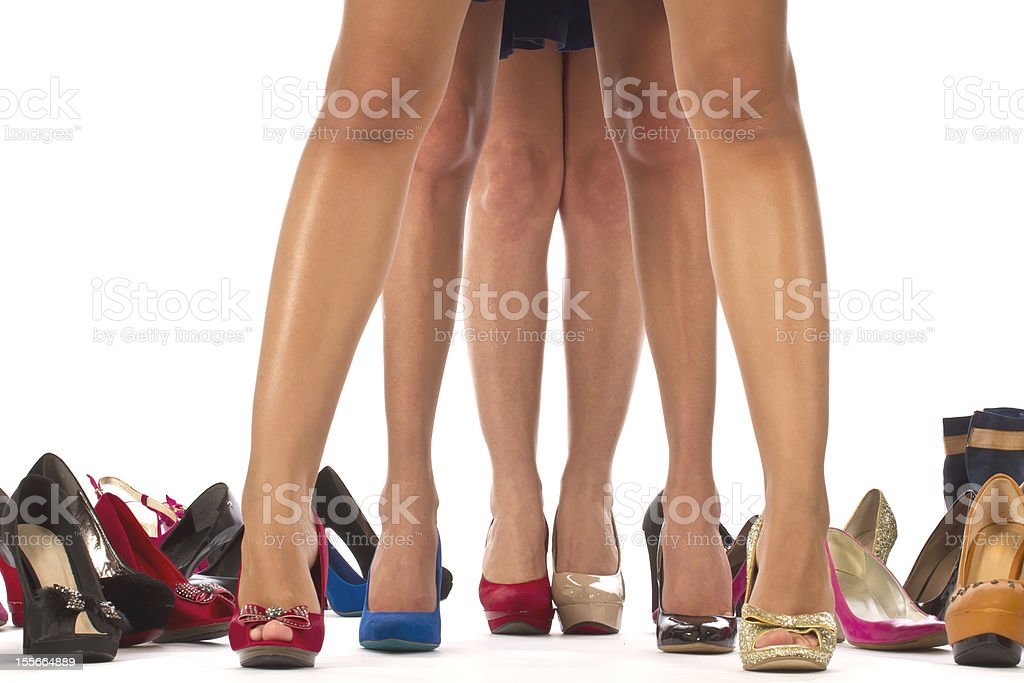 Female legs with different shoes stock photo