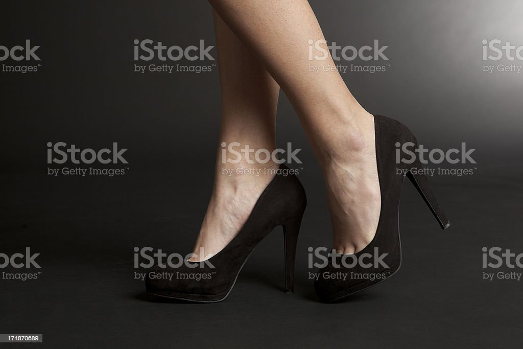 Female legs with high heels royalty-free stock photo