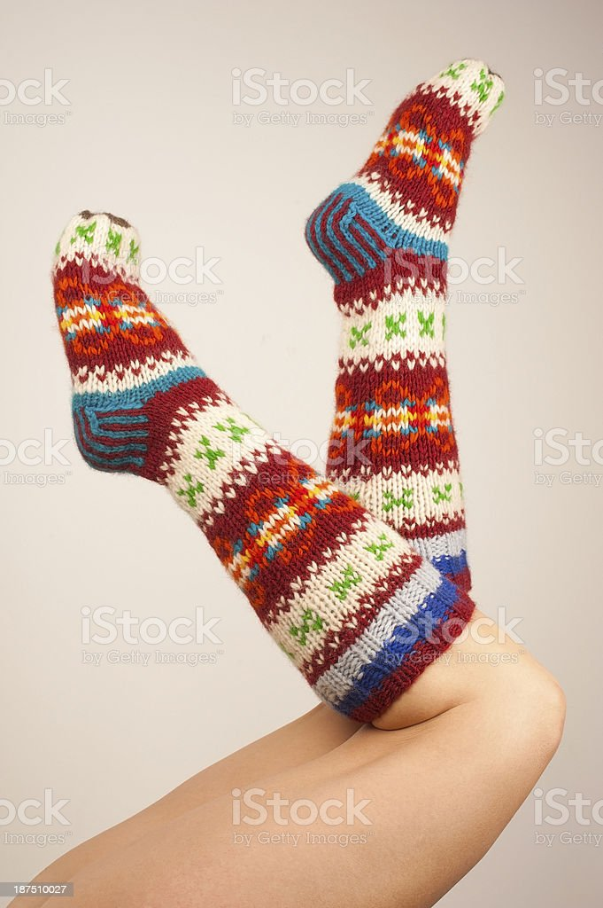 Female Legs with Multicolored Woolen Socks royalty-free stock photo