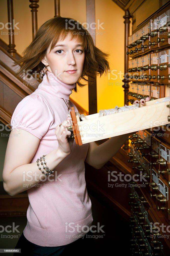 Female librarian working with the library card index royalty-free stock photo