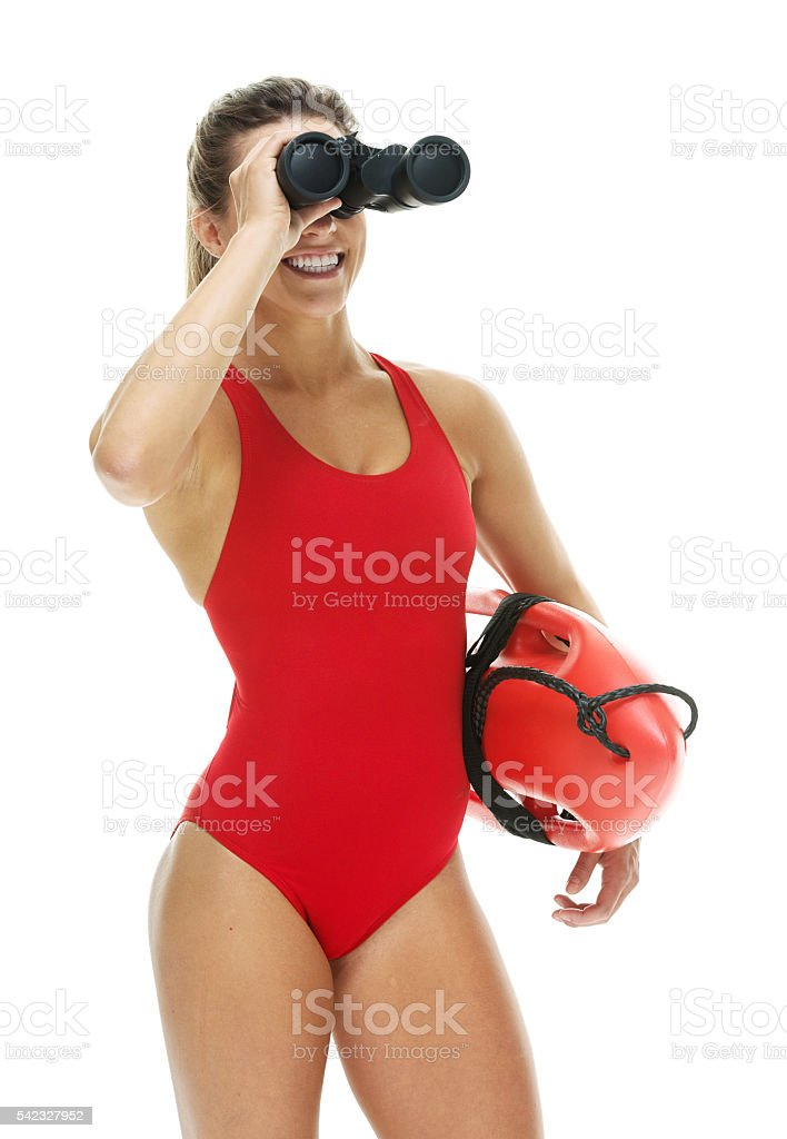Female lifeguard searching with binoculars stock photo