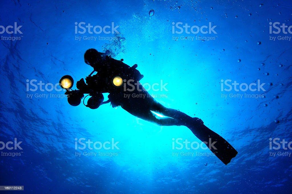 Female light under sunlight underwater stock photo