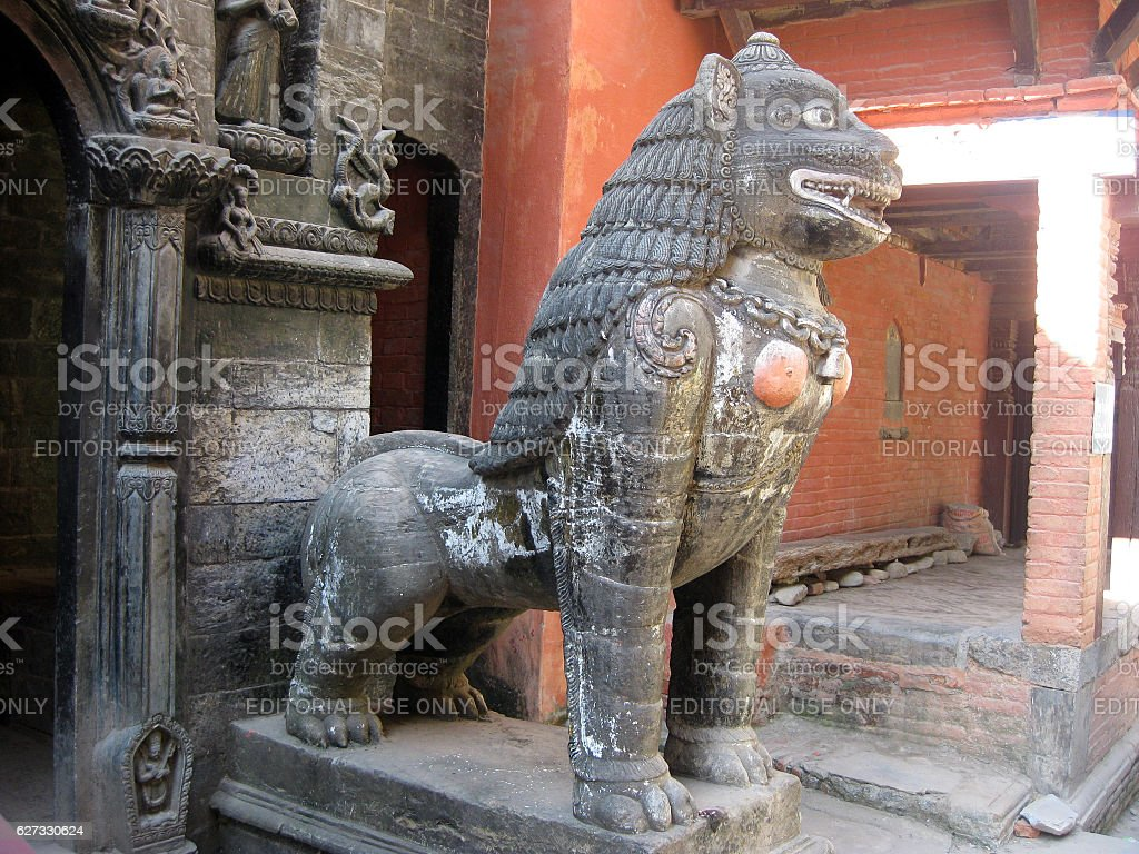 Female lion statue of the Golden Temple in Patan stock photo