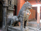 Female lion statue of the Golden Temple in Patan