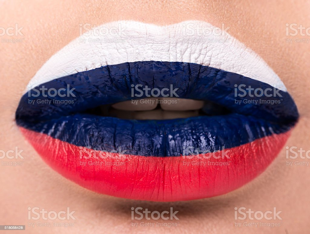 Female lips close up with a picture flag of Russia stock photo