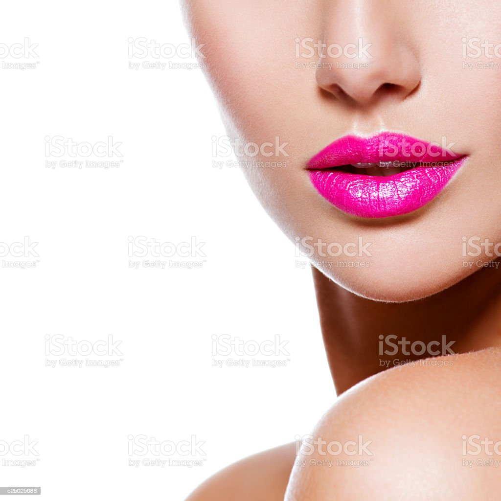 Female lips with pink lipstick. closeup. half face stock photo