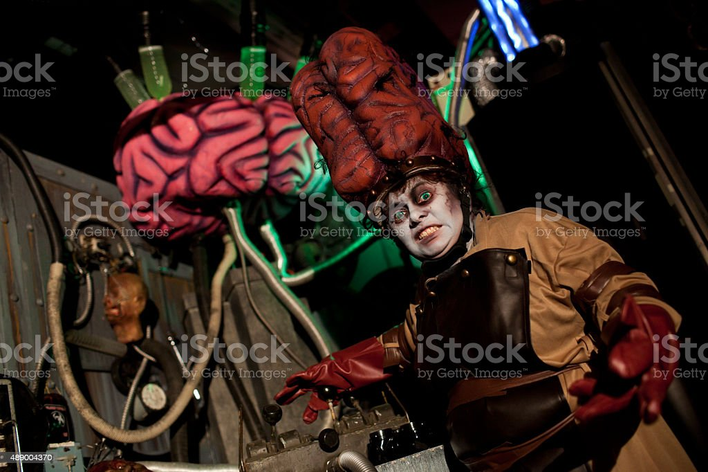 Female Mad Scientist with Large Brains stock photo