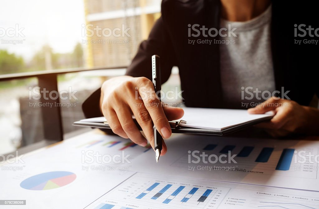 female manager putting his ideas and writing stock photo