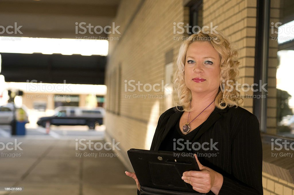 Female Manager with tablet outside office building stock photo