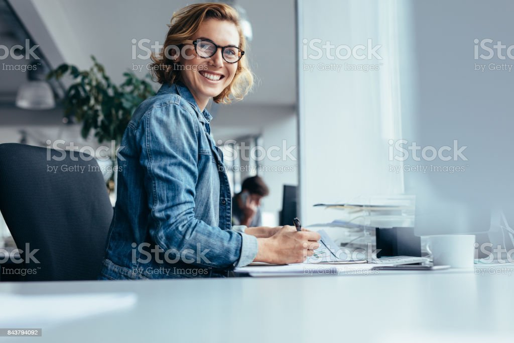 Female manager working at her desk stock photo
