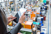 Female manager working on tablet in factory