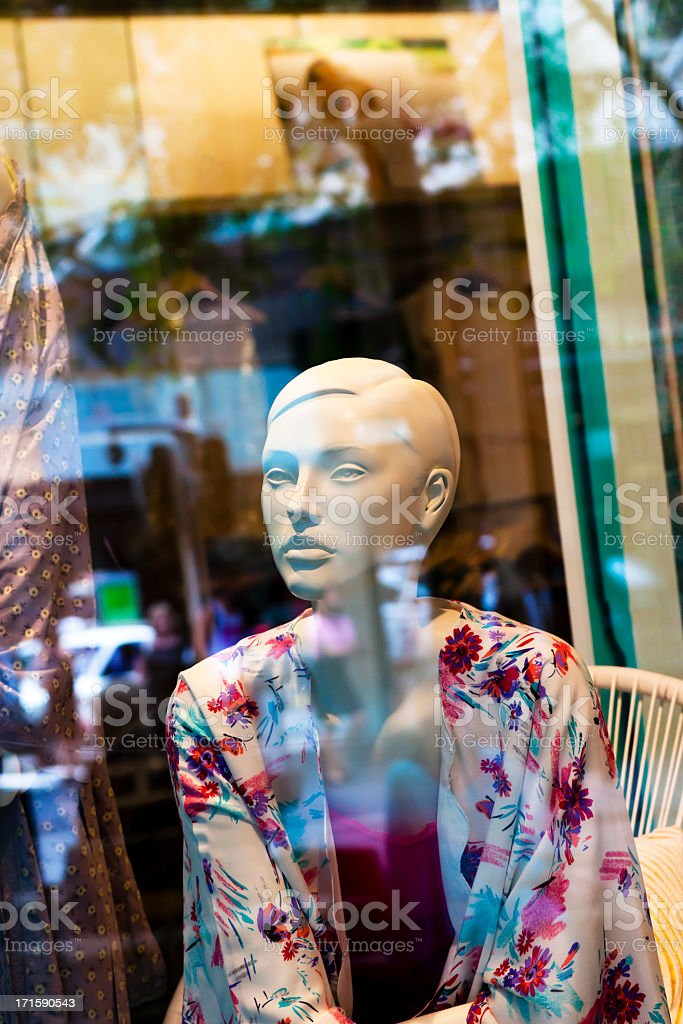 Female mannequin in shop window with street reflection royalty-free stock photo