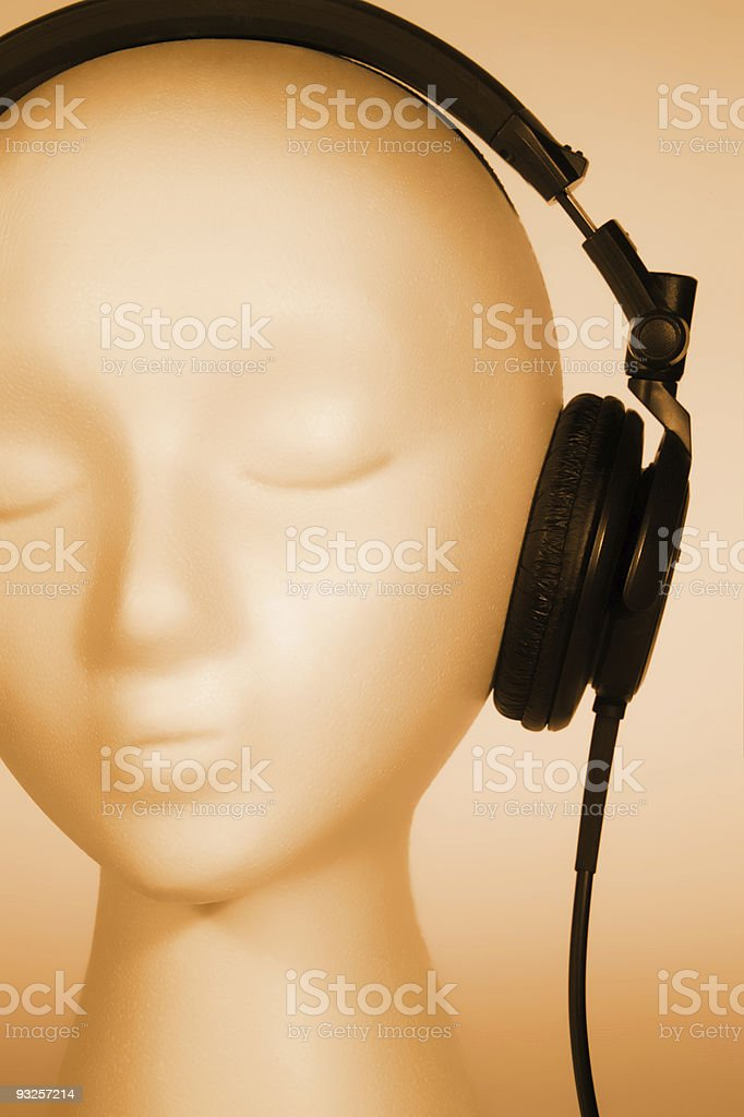 Female Mannequin listening to Music royalty-free stock photo