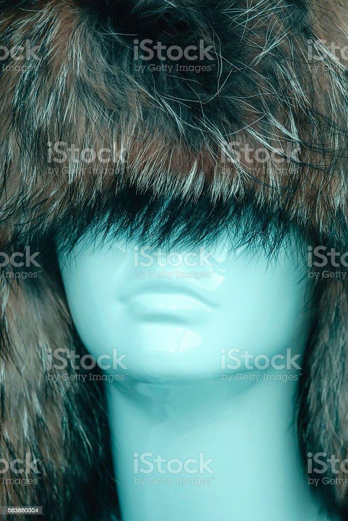 Female mannequin wearing oversize frontier hat in store window display stock photo