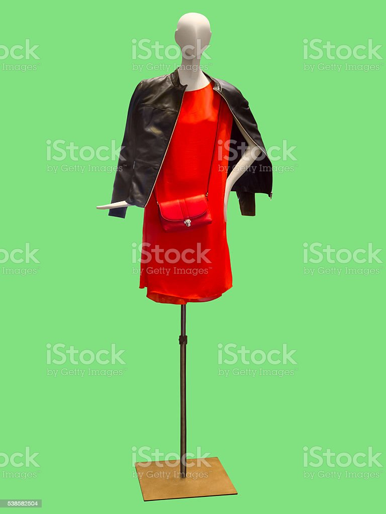 Female mannequin wearing red dress and leather jacket. stock photo