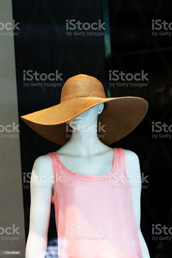 Female mannequin with straw hat and pink dress, copy space royalty-free stock photo