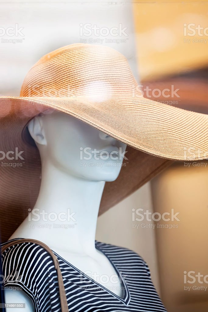 Female mannequin with straw hat royalty-free stock photo