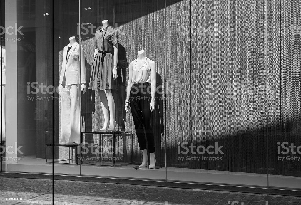 Female mannequins in a shop window. Black and white photo stock photo
