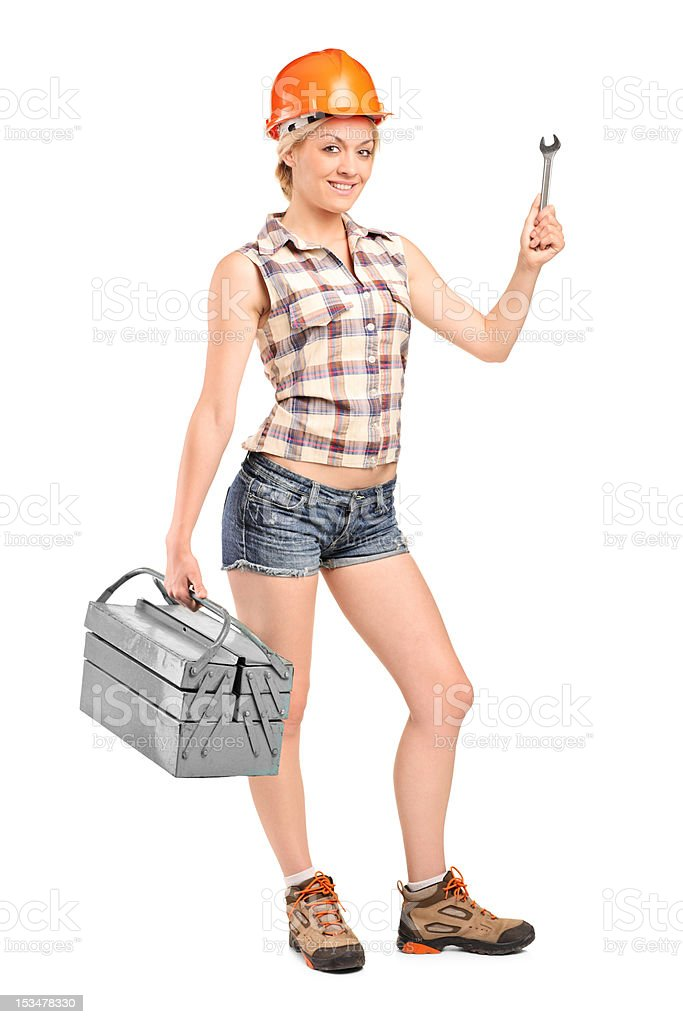 Female manual worker holding a tool royalty-free stock photo