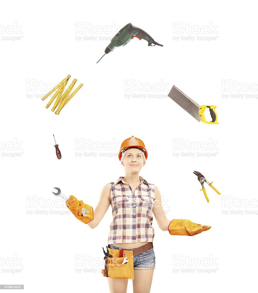 Female manual worker juggling with tools royalty-free stock photo