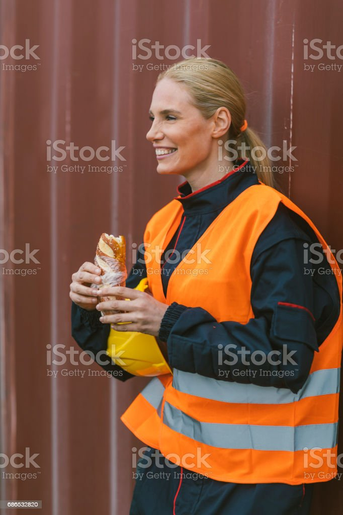 Female manual worker on lunch break stock photo