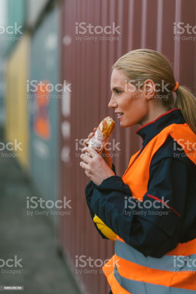 Female manual worker on lunch break stock photo