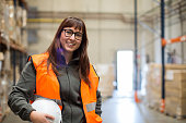 Female manual worker portrait smiling at camera.