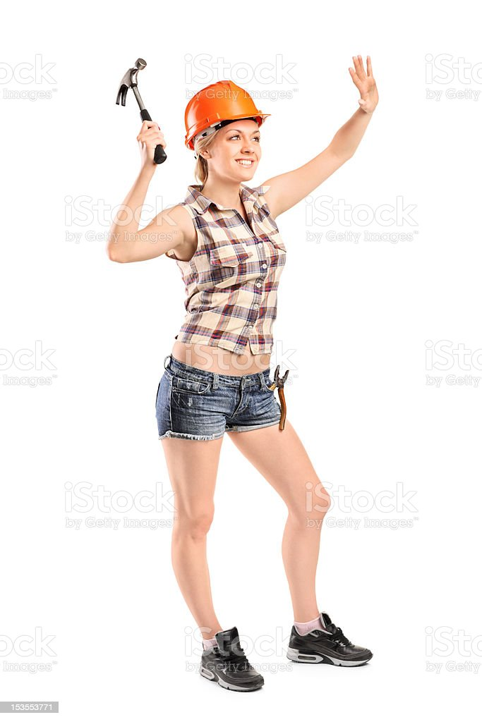 Female manual worker with hammer royalty-free stock photo