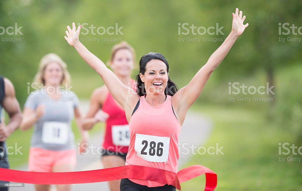 Female marathon runner winning race stock photo