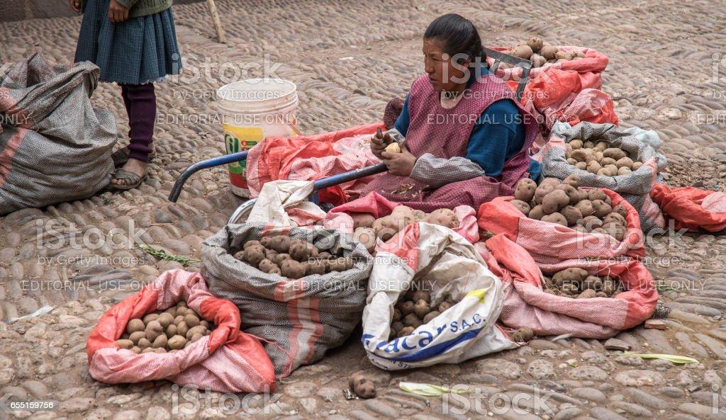Female market vendor at stall stock photo