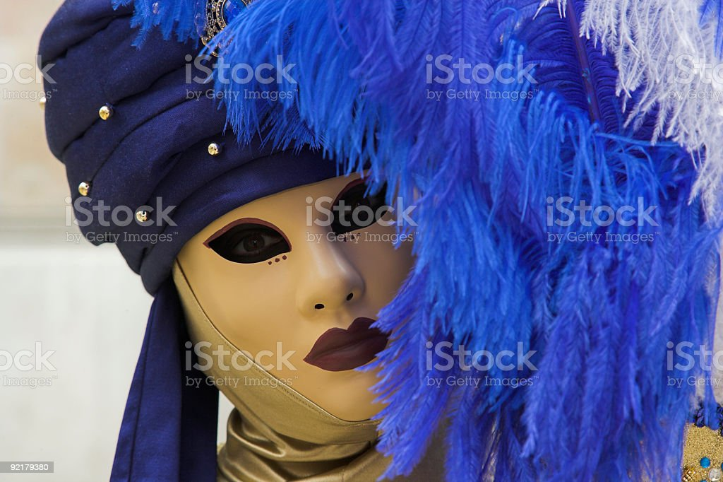 Female mask with blue feather at carnival in Venice (XXL) royalty-free stock photo