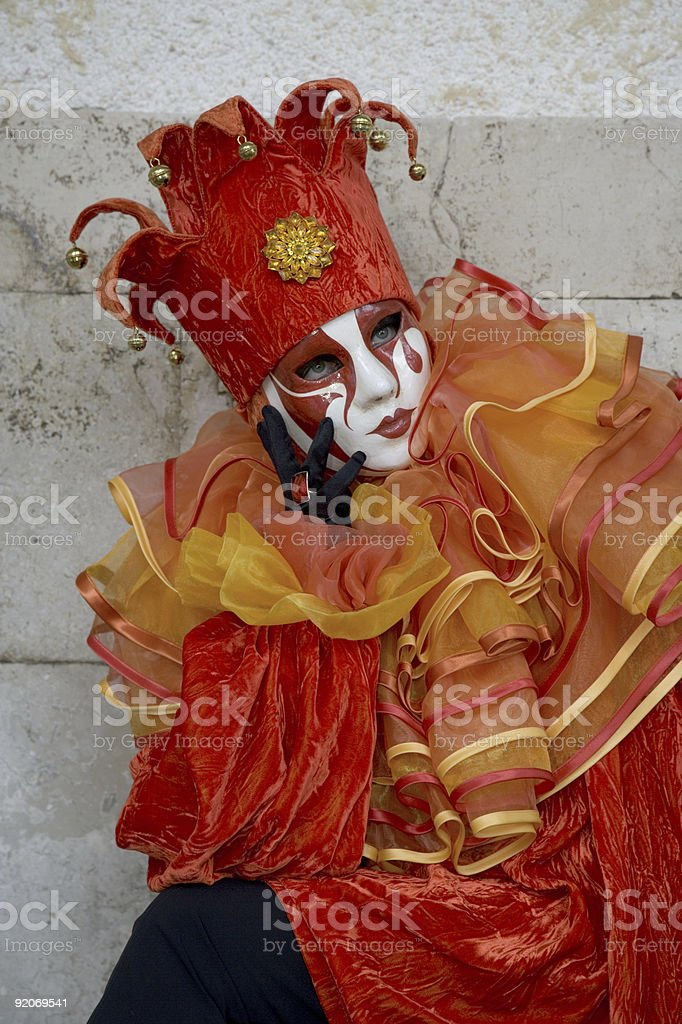 Female mask with red harlequin costume at carnival in Venice stock photo