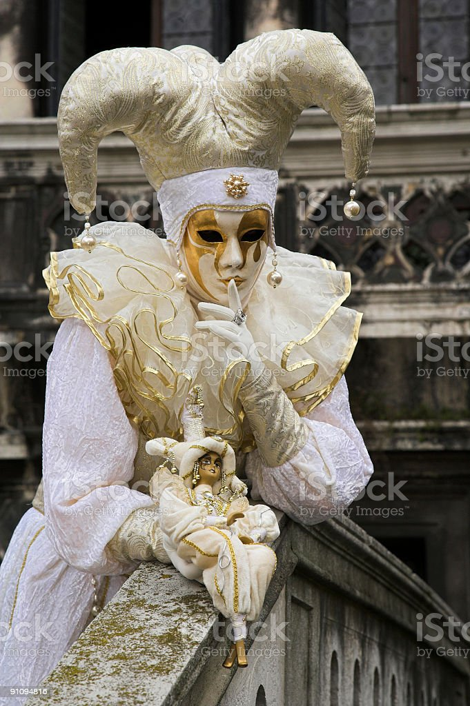 Female mask with white Jester costume at carnival in Venice stock photo