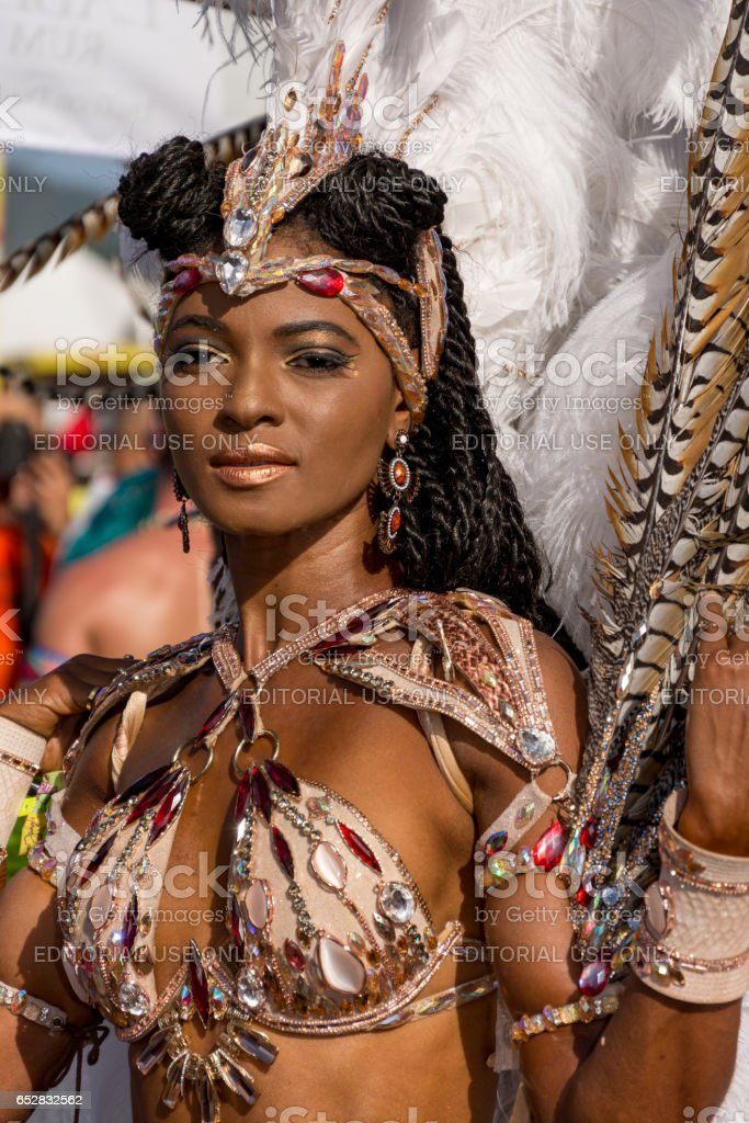 A Female Masquerader enjoys herself in the Harts Carnival presentation- Ultraviolet Jungle stock photo