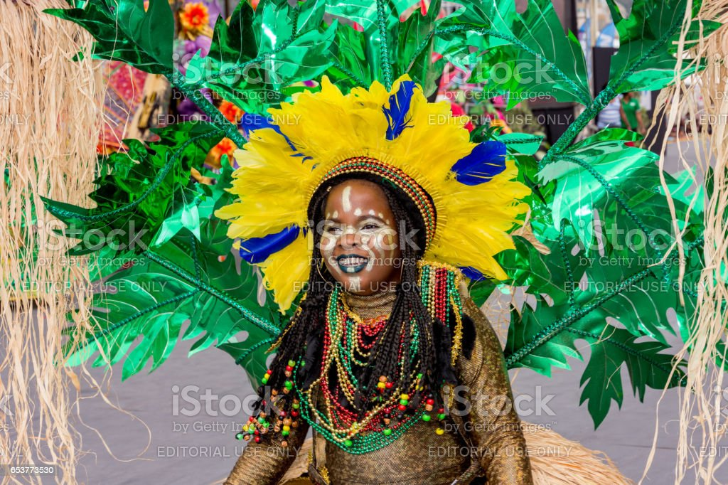 A Female Masquerader enjoys herself in The Trinidad Red Cross 2017 Children's Carnival stock photo