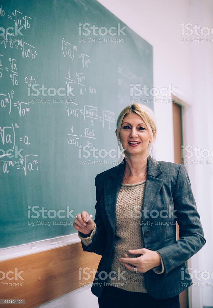 Female math professor in lecture hall stock photo