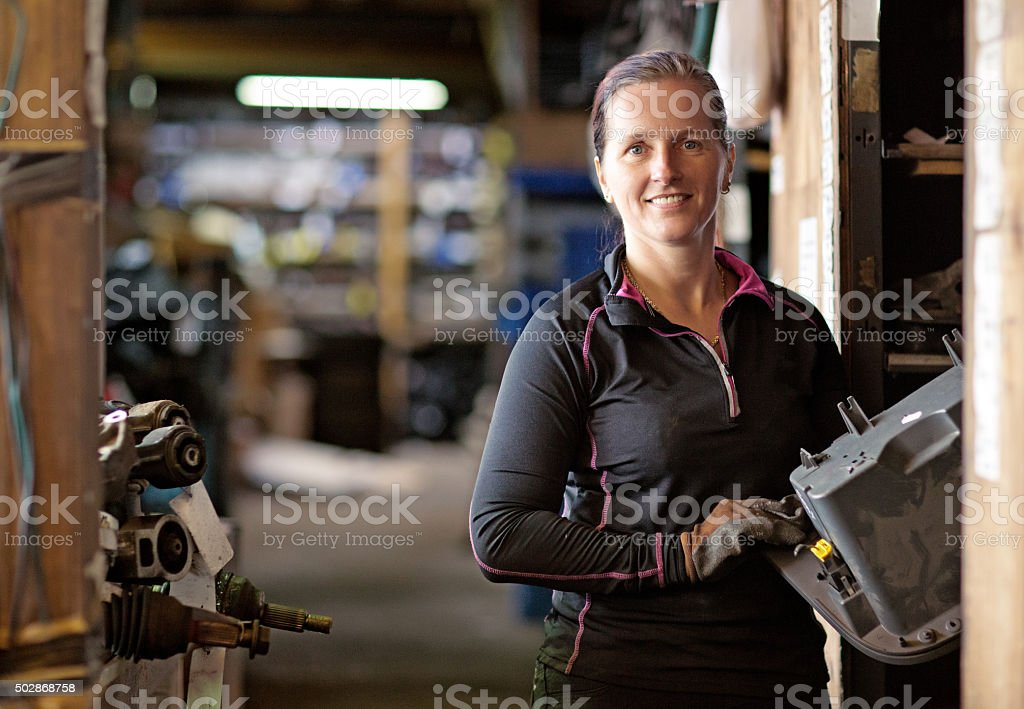 Female mechanic at a storage centre stock photo