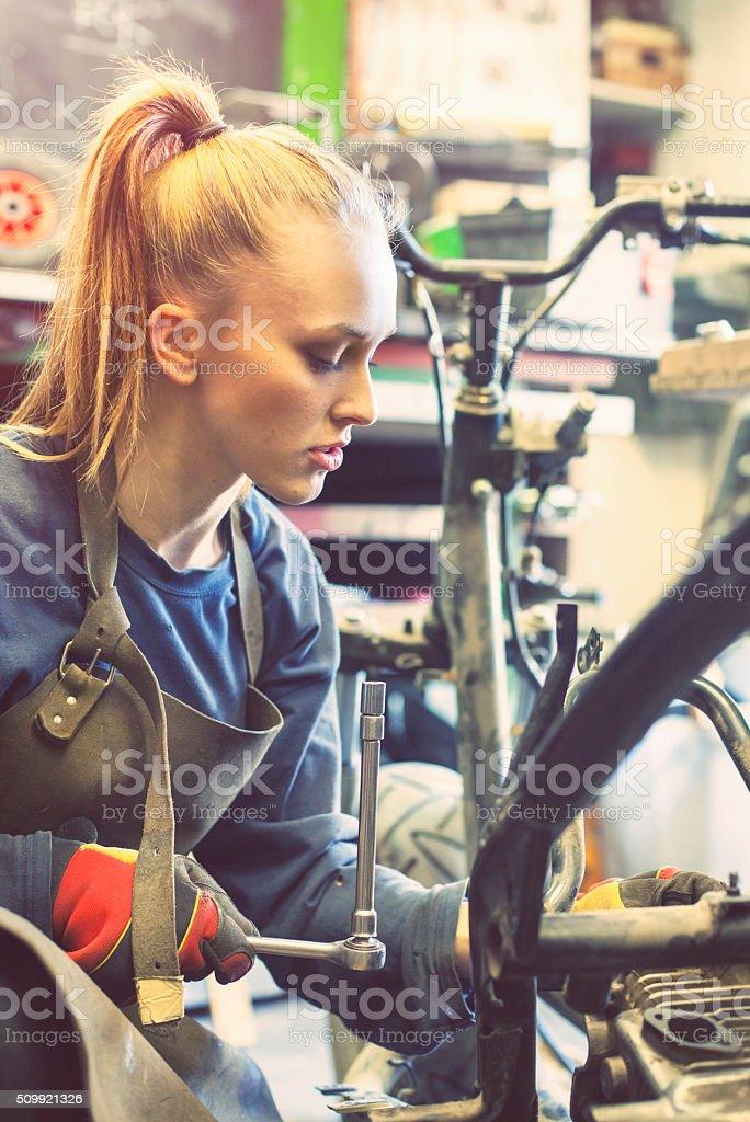 Female mechanic at work stock photo