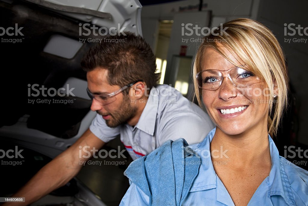 Female mechanic. Automobile repair shop. Working. Blue collar. stock photo