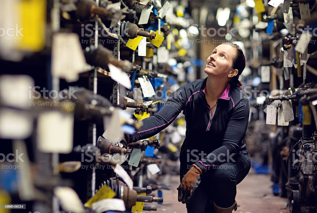 female mechanic working at storage stock photo